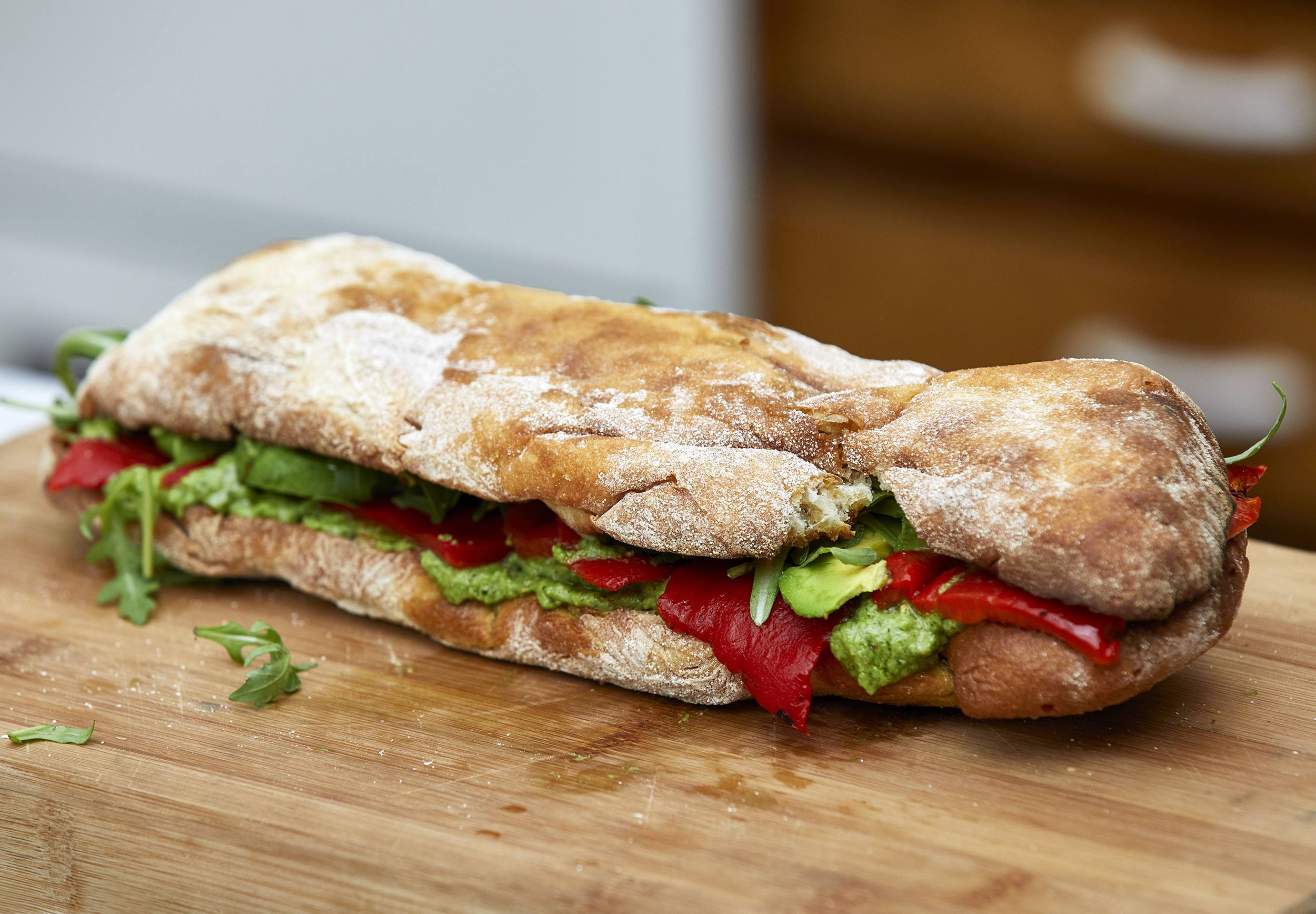 recipe image Pea, Basil and Pine Nut Pesto Ciabatta with Roasted Red Pepper, Avocado and Rocket